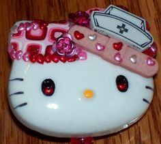Casting Kitties Lovin' Nurse ID Badge Retractable Reel Holder This kitty is embellished with a nurses hat band aid plaid heart aluminum pink flowers and lots of pink red and Nursing Board, Nurse Hat, Band Aid, Stethoscope, Id Badge, Badge Holders, Nurses, Pink Flowers, Hello Kitty