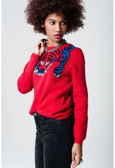 red knit sweater with tiger design on the front