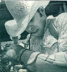 Chris LeDoux tying his glove on, getting ready to ride his bronc.