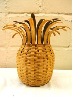 This is an epic vintage pineapple basket! It is in wonderful condition with no broken parts and none of the weave coming apart! It has the