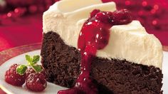 Start with a spectacularly rich flourless cake, then top with an over-the-top chocolate layer accented with tart-sweet raspberry-currant sauce.