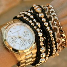 bracelets and watch in gold layers