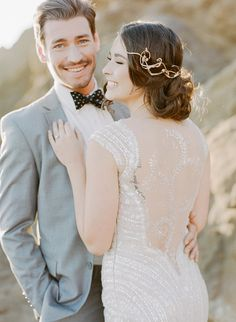Plenty of dresses are just as stunning from the back. While options abound to get a picture of you walking away, consider including the lucky man. Photo by Sylvie Gil Photography via Style Me Pretty