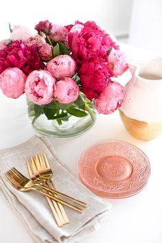 Pink peony centerpiece, pink glass plates, gold flatware