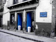 The Blue Door Bakery-San Miguel. Love the black & white w/ pop of blue