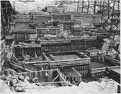 The construction of a group of concrete blocks near the east end of the Grand Coulee Dam. April 1, 1937