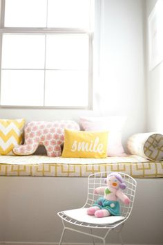 little girl's room, window seat, Celerie Kemble fabric, Rikshaw elephant pillow, HoneyPie smile and zig zag pillow, pink, yellow (Style at Home: Erika of Small Shop Studio. Photographed by Jennifer Daigle)