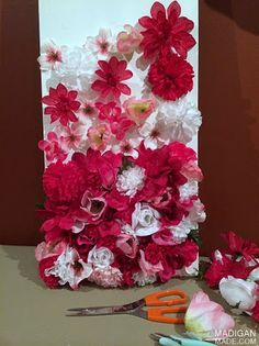 gluing loose silk flowers to art canvas | bottom of the canvas, upwards. I started out by applying the flowers ...