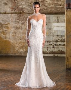 Justin Alexander signature wedding dresses style 9832 Beaded illusion tulle Mandarin neckline, illusion back neckline, and sleeves, adorn this Signature allover beaded tulle and lace fit and flare gown with a chapel length train.