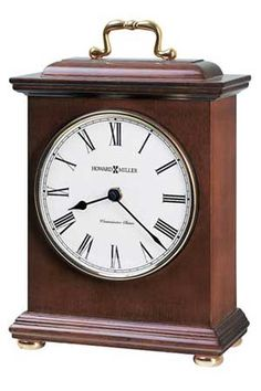"The Howard Miller Tara 635-122 Mantel Clock features a decorative brass-finished handle, polished brass finished bezel, and turned, polished brass bun feet. An off-white dial under convex glass features black Arabic numerals and black hands. Quartz movement plays Westminster melody on the hour and counts the hour. Finished in Windsor Cherry on select hardwoods and veneers. Automatic nighttime chime shut-off option. Size: H. 10"" W. 6-1/2"" D. 3-1/4"""