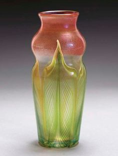 A DECORATED FAVRILE GLASS VASE   TIFFANY STUDIOS, CIRCA 1908   7in. (17.8cm.) high   engraved 2306 C L.C. Tiffany-Favrile