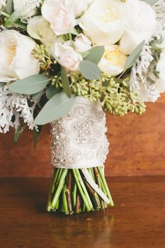 Beaded Bouquet Wrap - See the wedding here: http://www.StyleMePretty.com/little-black-book-blog/2014/05/14/classic-elegant-pelican-hill-resort-wedding/  Photography: One Love Photo - onelove-photo.com - #smp
