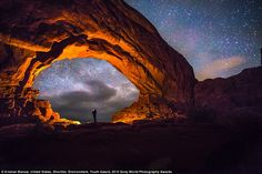 Youth entrant Krishnan Bansal wrote: 'Just me, observing the stars above ancient sandstone landscape of Arches National Park. It's amazing how when we view our earthly environment in its natural state, the more alien it becomes. Single exposure, no composites'
