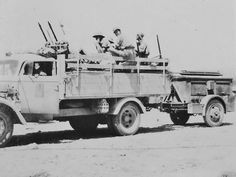 Afrika Corp modified Opel truck with anti aircraft guns pulling an amo supply trailer.