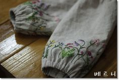 embroidered flowers on sleeves