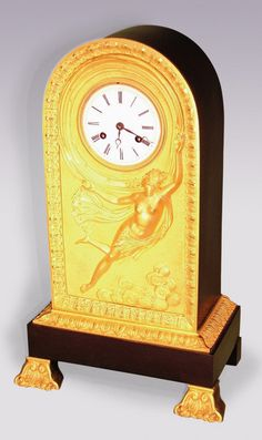OnlineGalleries.com - An early 19th century French bronze and ormolu arched clock