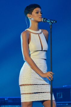 Rihanna looking like fyah in this Alexander Wang white cut out dress from Spring Summer 2013.