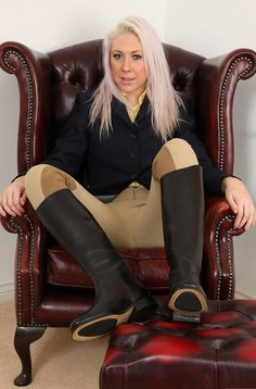 Sexy blonde in breeches and leather riding boots