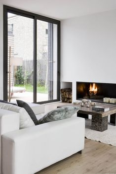 White, modern with a nice fireplace