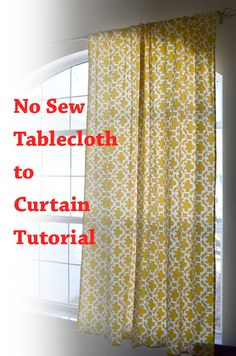 No sew curtains from a tablecloth with hidden tabs made from ribbon and hot glue.