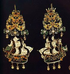 Gold earrings from the Greek island of Sifnos, 17th-18th century. Sailing ships with elaborate colorful enamels and pearls, reflecting  European Rococo; earring have bows with a crown on top. Athens, Benaki Museum