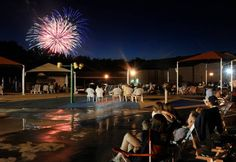 Friends and families gather on the deck of the Massad Family YMCA water park in Stafford County to celebrate July 4th.