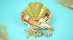 Origami clam shell... #Origami #beach #shell #art #crafts Origami Day, Shell Art, Art Crafts, Clam, Tinkerbell, Disney Characters, Fictional Characters, Shells, Disney Princess