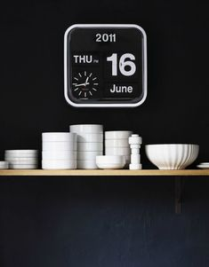 love the wooden open shelving, white dishes, also love the clock (Via doorsixteen, photo by David Prince)