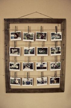 Use twine and clothes­pins to hang pho­tographs in a reclaimed wood frame