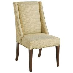 Our classic wingback chair soars into a new era. Hand-upholstered in a woven, tone-on-tone fabric, Owen features modified flat wings and nailhead trim on all sides. Its squared legs are solid hardwood with an espresso finish. Perfect for the dining, bedroom or office.