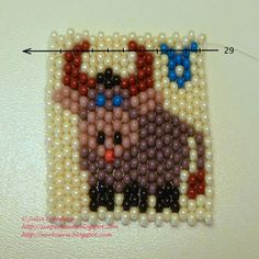 Free detailed tutorial with step by step photos on how to make a keychain with zodiac sign Taurus out of seed beads in peyote stitch. Great for beginners!