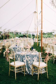 Nautical tented wedding decor: http://www.stylemepretty.com/maine-weddings/cape-elizabeth-maine/2016/01/11/coastal-maine-summer-wedding-at-the-inn-by-the-sea/ | Photography: Emily Delamater - http://emilydelamater.com/: