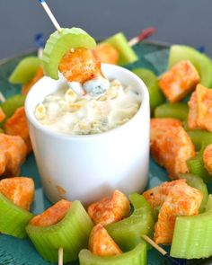 These spicy Buffalo Chicken Bites are a great as a party appetizer or to bring to your next potluck. Buffalo chicken, celery and blue cheese dip– all in one bite! Cheap Appetizers, Chicken Appetizers, Appetizers For Party, Appetizer Recipes, Skewer Appetizers, Antipasto Platter, Chicken Meals, Chicken Recipes, Buffalo Chicken Bites