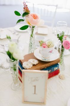 books and tea cups centerpiece - photo by blf Studios
