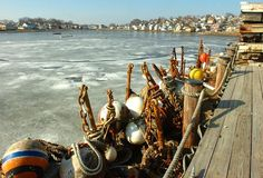 Near Stamboat Wharf stored moorings frame the frozen water of the Weir River, Sunday, Jan 6, 2013, in Hull.  Gary Higgins/The Patriot Ledger Purchase this photo $8