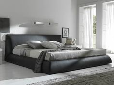 this would be perfect for my clumsy self. no stubbing my toes, no hittin my head, i just just carelessly plop down on the bed.  if only it were pretty. :D