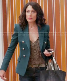 Abby's gold beaded top and green blazer on Girlfriends Guide to Divorce