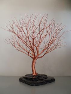 Copper Tree - We are proud to be the exclusive dealer in CT of these beautiful hand made metal sculptures reminiscent of the windblown trees on our eastern shoreline. The artist creates table sculptures as well as wall hung single trees.