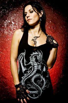 Cristina Scabbia - Cristina Adriana Chiara Scabbia (Milão, 6 de Junho de 1972) é vocalista da banda italiana de gothic metal Lacuna Coil juntamente com Andrea Ferro.