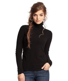 #travelessentials the perfect travel look. Messy but cute and comfy and not out of place in any area. Black turtleneck and a braid and jeans and boots