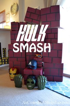 Hulk Smash Wall: Superhero Party | As Cute as a Bug's Ear|  The Hulk Smash Wall will go down in history as the most-loved party game to date!  I have yet to find something that people of all ages enjoyed more… seriously, causing chaos and destruction is just too much fun!  Add a Hulk Mask and Hulk Hands?!?  Match made in history.