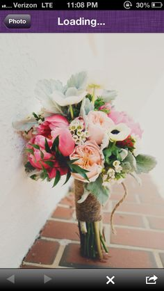 Love the coral, peach, light aqua colors together, but not really the arrangement.