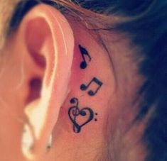 Black Heart Treble Clef With Music Knots Tattoo On Left Behind The Ear