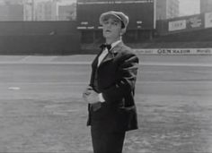 Buster mimes a one man ballgame in Yankee Stadium