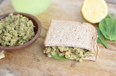 "Classic pesto sauce mixed with smashed chickpeas and smothered between two slices of bread for a modern twist on a ""salad"" sandwich. Vegetarian, healthy, flavorful and simple."