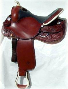 SELLA GARLAND art.GD308RTT  nel  colore burgundy, con seggio in vitello testa  di moro. Pomo, paletta e staffe in rawhide e lavorazione  rose tooling.