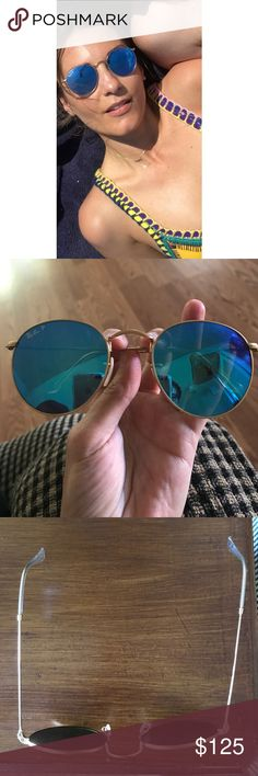 Ray-Ban Polarized Flash Blue Mirror Lenses Amazing glasses for summer these lenses are mirrored and a beautiful bright shade of blue. Comes with case. They are in excellent condition the one problem as shown is that they need to be brought to sunglass hut for the arm to be tightened. Right now it is loose so it goes off to the right as pictured. This is an easy and free fix at sunglass hut. These made me so happy!!! Ray-Ban Accessories Sunglasses