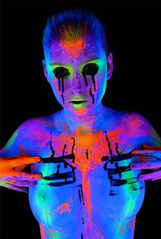 Wonderful black light bodypaint painted by Wolf Reicherter
