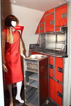 An Eastern Airlines flight attendant with an Eastern Airlines food cart inside a Pan Am kitchen model from the 1970's | Flickr - Photo Sharing!