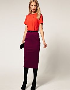 I love the color of this skirt and the zipper detail on the back.